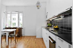 A kitchen or kitchenette at Exclusive apartment Stockholm