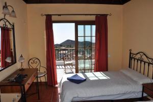 Ein Bett oder Betten in einem Zimmer der Unterkunft Sur