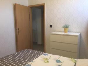 Ein Bett oder Betten in einem Zimmer der Unterkunft Ferienapartments Sonnenhof