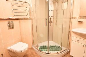 Ванная комната в Отель Сан Сити