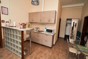 Кухня или мини-кухня в Отель Сан Сити