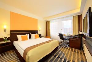 Ein Bett oder Betten in einem Zimmer der Unterkunft Hotel Duo