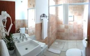 A bathroom at Le Garden Pousada Boutique