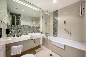 Ein Badezimmer in der Unterkunft Hotel Duo