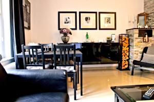 Ein Restaurant oder anderes Speiselokal in der Unterkunft Luxus City