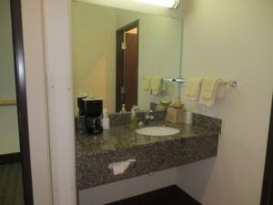 A bathroom at North Park Inn & Suites