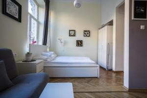 Łóżko lub łóżka w pokoju w obiekcie Elegant Apartment Copernicus
