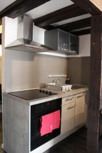 O bucătărie sau chicinetă la Apartment les Violettes