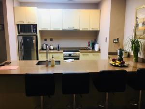 A kitchen or kitchenette at JCB Dubai Marina Apartment
