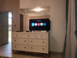 A television and/or entertainment center at JCB Dubai Marina Apartment