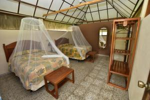 A bed or beds in a room at Tikal Inn