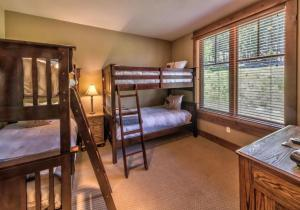 A bunk bed or bunk beds in a room at East West Hospitality at Tahoe