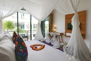 A bed or beds in a room at Sabana Ubud