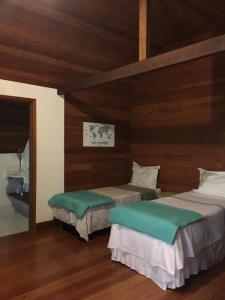 A bed or beds in a room at Nosso Sítio - Rancho Santa Clara Itaipava