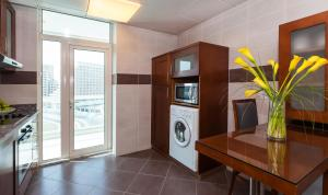 A kitchen or kitchenette at Flora Creek Deluxe Hotel Apartments