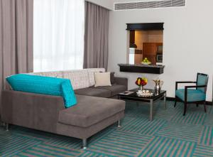 A seating area at Flora Creek Deluxe Hotel Apartments