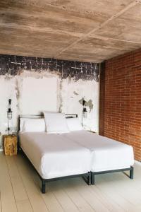 Cama o camas de una habitación en Barcelona Apartment Republica