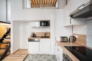 Cuisine ou kitchenette dans l'établissement DIFY Bear & Co - Hotel de Ville