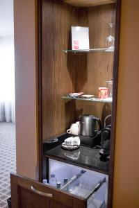A kitchen or kitchenette at Grand Hotel Huis ter Duin