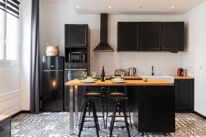 Cuisine ou kitchenette dans l'établissement DIFY Dauphiné - Part Dieu