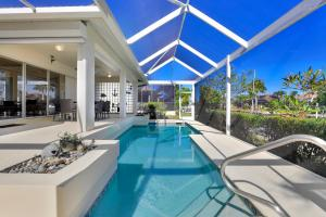 The swimming pool at or close to Waterfront Marco Island Vacation Home With Private Pool