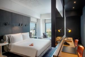 A bed or beds in a room at Canopy by Hilton Dubai Al Seef