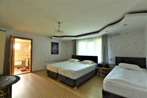 A bed or beds in a room at Jamilya B&B Guest House