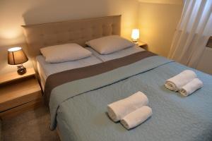 Кровать или кровати в номере Dom św. Józefa