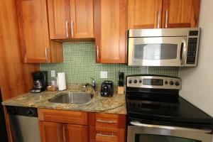 A kitchen or kitchenette at Beach Club at Anna Maria Island by RVA