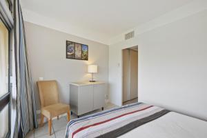 Cama o camas de una habitación en Résidence Pierre & Vacances Heliotel Marine