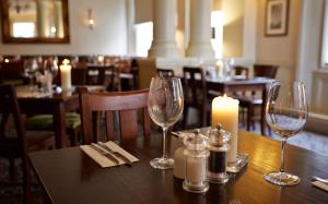 A restaurant or other place to eat at George Hotel by Greene King Inns