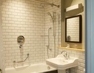 A bathroom at Red Lion Hotel by Greene King Inns
