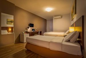 Cama ou camas em um quarto em H3 Hotel Paulista