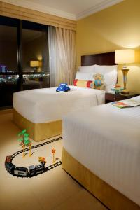 A bed or beds in a room at Marriott Executive Apartments Manama, Bahrain