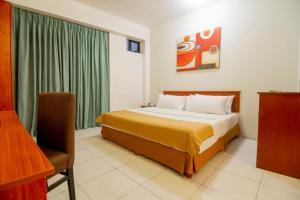 Cama o camas de una habitación en El Dorado Express Hotel