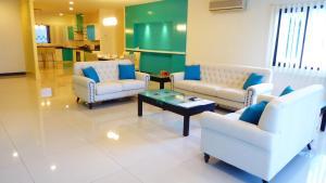 A seating area at Rimbun Suites & Residences