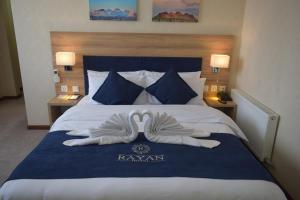 A bed or beds in a room at Rayan Hotel