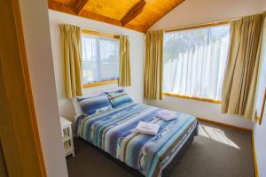 Postel nebo postele na pokoji v ubytování Beauty Point Tourist Park