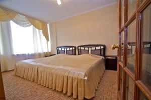 Кровать или кровати в номере Пансионат «Эдем»