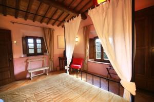 A bed or beds in a room at Molino Di Foci