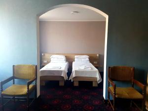 A bed or beds in a room at Institutul Muncii