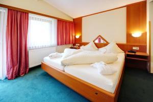 Postel nebo postele na pokoji v ubytování Hotel Riederhof
