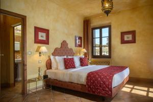 A bed or beds in a room at La Bagnaia Golf & Spa Resort Siena - Curio, A Collection by Hilton