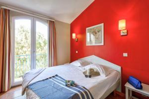 Un ou plusieurs lits dans un hébergement de l'établissement Résidence Pierre & Vacances le Hameau de la Pinède