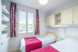Un ou plusieurs lits dans un hébergement de l'établissement Village Pierre & Vacances Le Rouret