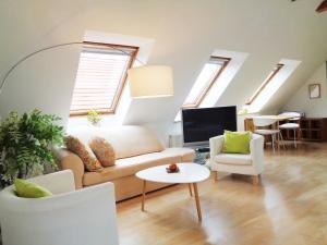 Ein Sitzbereich in der Unterkunft Hotel Apartment Puell