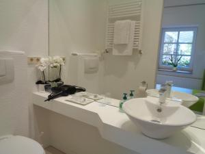 Ein Badezimmer in der Unterkunft Hotel Apartment Puell
