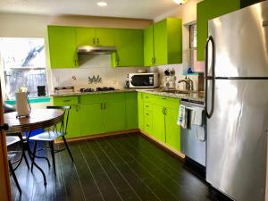 A kitchen or kitchenette at The Cove BNB