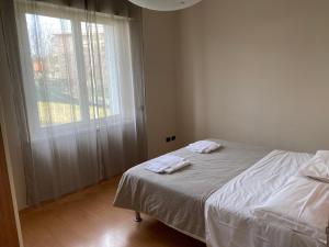 Letto o letti in una camera di Villa Alba Malpensa