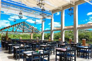 A restaurant or other place to eat at Pousada Bixu de Pé